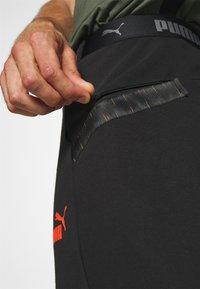 Puma - CASUALS PANT - Pantalon de survêtement - black/fizzy orange - 3