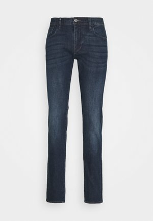 POCKETS PANT - Slim fit jeans - indigo denim