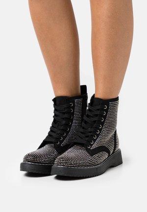 KURRT - Platform ankle boots - black/multicolor