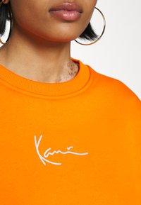 Karl Kani - SMALL SIGNATURE CREW - Sweatshirt - orange - 5