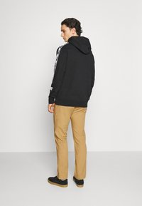 Tommy Jeans - ETHAN BLEND PANT - Chino kalhoty - beige/camel - 2