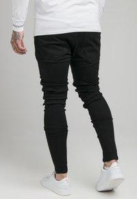 SIKSILK - RAW HEM BURST KNEE - Jeans Skinny Fit - black - 2