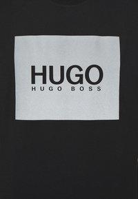 HUGO - T-shirt con stampa - black - 5