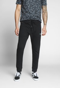 Replay - Tracksuit bottoms - black - 0