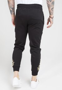 SIKSILK - FITTED  - Tracksuit bottoms - jet black/gold - 2