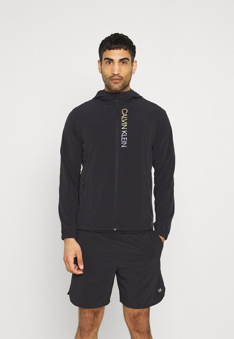 Calvin Klein Performance - PRIDE WINDJACKET - Training jacket - black