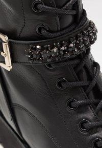 Steven New York - XIAMARA - Cowboy/biker ankle boot - black - 2