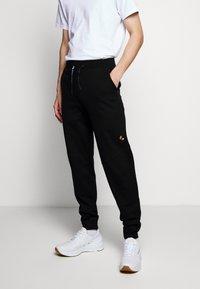 Raeburn - Pantaloni sportivi - black - 0