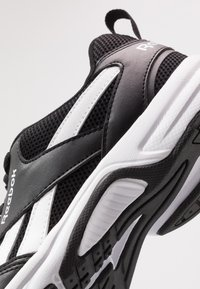 Reebok - PHEEHAN - Neutral running shoes - black/white - 5