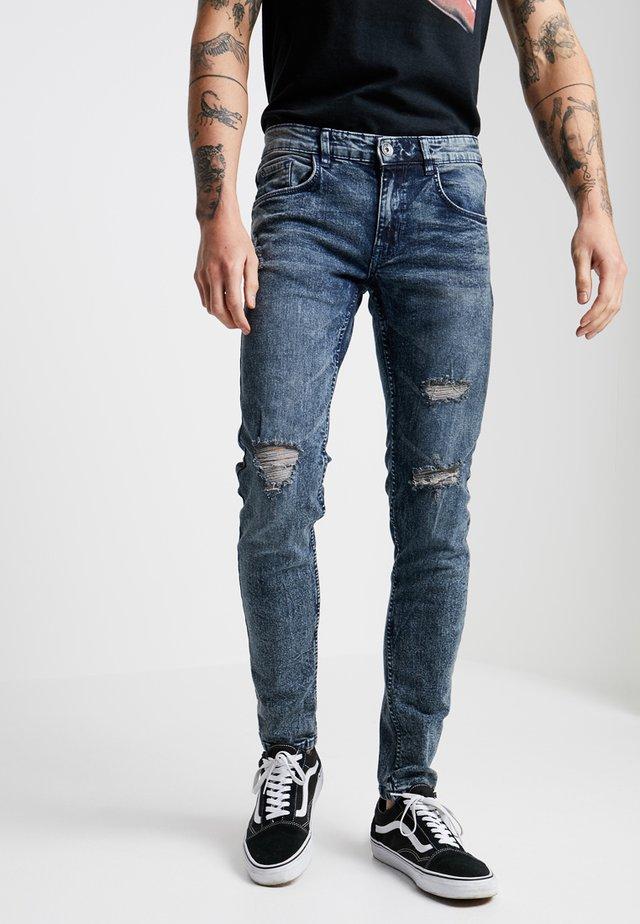 STOCKHOLM DESTROY - Jeansy Skinny Fit - dark blue denim