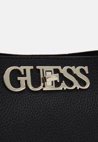 Guess - UPTOWN CHIC TURNLOCK SATCHEL - Handbag - black - 3