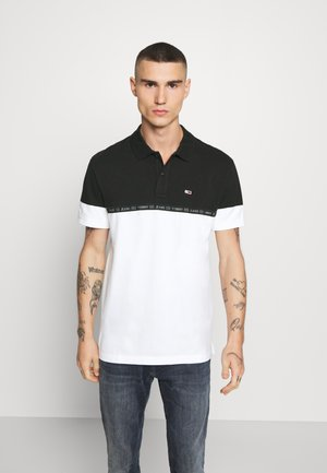 TAPE  - Polo - black / multi