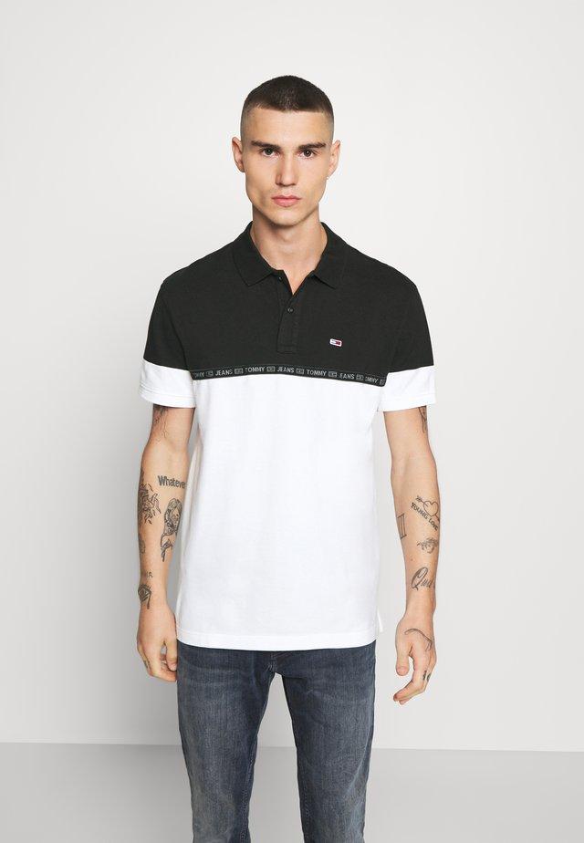 TAPE  - Polo - black / multi