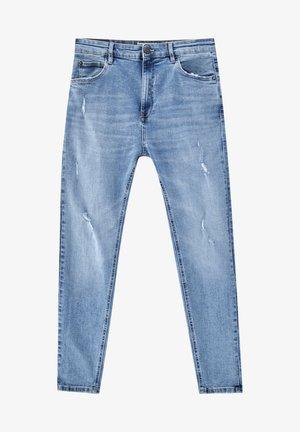 Zúžené džíny - mottled dark blue