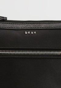 DKNY - CASEY ZIP CROSSBODY - Taška spříčným popruhem - black - 6