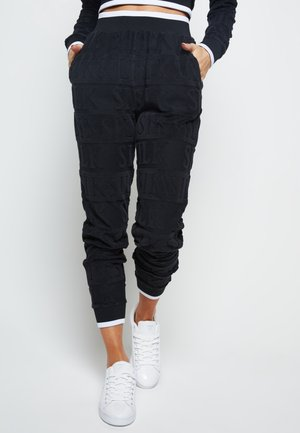 INVERSE  - Tracksuit bottoms - black