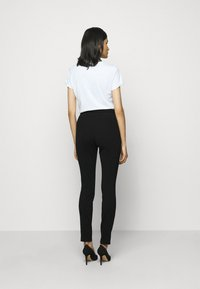 HUGO - HENIAS - Leggings - Trousers - black - 2