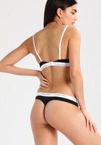 Calvin Klein Underwear - 2 PACK - Thong - black - 2