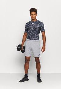 Under Armour - T-shirt imprimé - black - 1