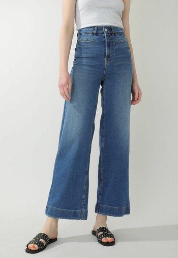 Flared Jeans - denimblau