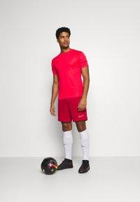 Nike Performance - SHORT - Sports shorts - university red/white - 1