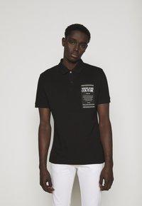 Versace Jeans Couture - PLAIN - Polo shirt - black - 0