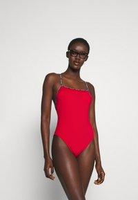 Calvin Klein Swimwear - CORE LOGO TAPE SQUARE NECK ONE PIECE - Swimsuit - rustic red - 1