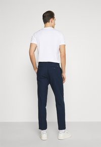 Tommy Hilfiger Tailored - PLEAT - Trousers - desert sky - 2