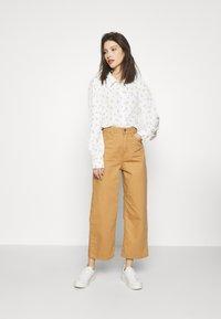 Monki - NALA BLOUSE - Button-down blouse - white light - 1