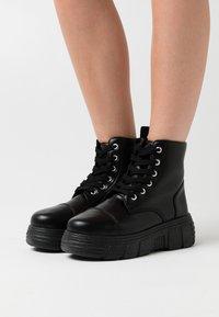 Koi Footwear - VEGAN - Platform ankle boots - black - 0