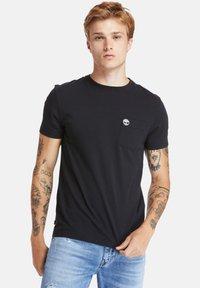 Timberland - SS DUNSTAN RIVER POCKET TEE - Basic T-shirt - black - 0