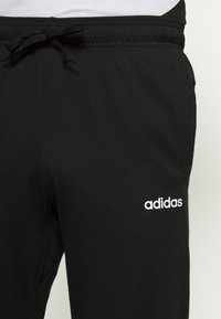 adidas Performance - ESSENTIALS SPORTS REGULAR PANTS - Tracksuit bottoms - black - 4