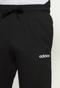adidas Performance - ESSENTIALS SPORTS REGULAR PANTS - Teplákové kalhoty - black - 4
