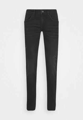 STOCKHOLM DESTROY - Slim fit -farkut - edgy black