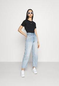 Nike Sportswear - TEE - T-shirt print - black/white - 1