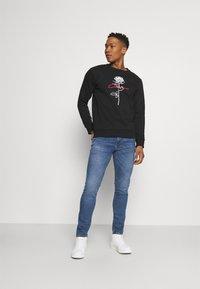 Levi's® - 510™ SKINNY - Slim fit jeans - med indigo - 1