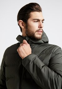 adidas Performance - HELIONIC DOWN JACKET - Chaqueta de invierno - olive - 3