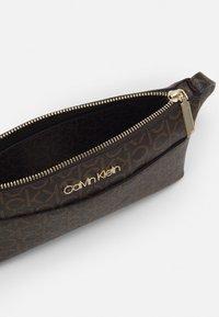 Calvin Klein - XBODY MONOGRAM - Taška spříčným popruhem - brown - 2