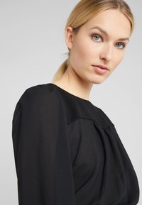 Patrizia Pepe - ABITO DRESS - Day dress - ivory/black - 3