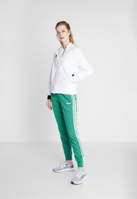 adidas Performance - PANT - Tracksuit bottoms - green/white - 1