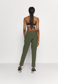 adidas Performance - TRAIN PANT - Tracksuit bottoms - olive - 2