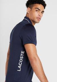 Lacoste Sport - Funktionströja - navy blue/onagre white - 3