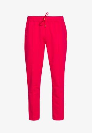 THEA - Spodnie treningowe - pink