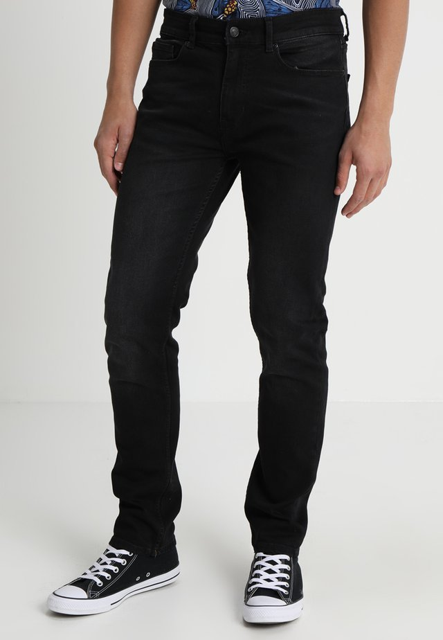 USED - Slim fit jeans - black