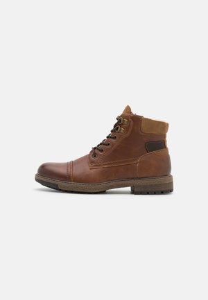VEGAN LANDONN - Lace-up ankle boots - cognac