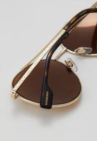 Burberry - Solglasögon - gold - 4