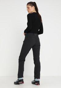 Vaude - WOMEN'S SKOMER WINTER PANTS - Outdoor trousers - black - 2