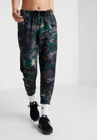 Nike Performance - REBEL ALL IN 7/8 - Tracksuit bottoms - club gold/white - 0