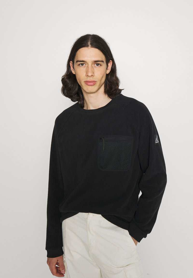 New Balance - ALL TERRAIN POCKET CREW - Fleece jumper - black