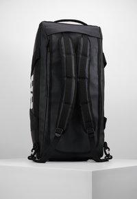 Helly Hansen - SCOUT DUFFEL M - Sports bag - black - 4